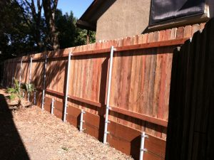 1X6X6 D.E. WITH STEEL POSTS ON RETAINING WALL