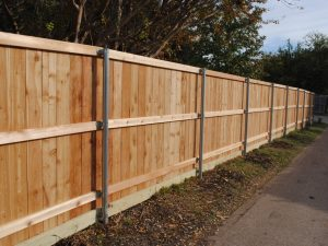 1. 1X6X6 REDWOOD WITH KICKBOARD AND ROUND STEEL POSTS