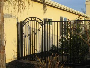 ARCHED IRON GATE WITH LEAVES
