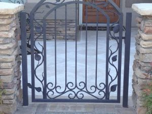 ARCHED IRON GATE WITH VINES AND LEAVES