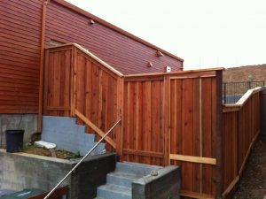 SLOPED FENCE WITH GATE