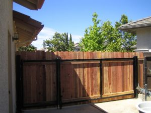 WOOD GATE AND FENCE, IRON FRAME AND POSTS